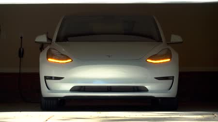 tesla car : RALEIGH, USA, JULY 03, 2018: A brand new white Tesla Model 3. The model 3 is set to be the Teslas first mass market electric vehicle Stock Footage