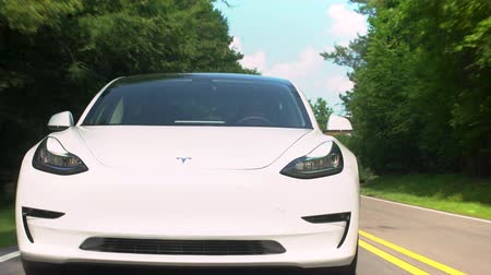 battery vehicle : RALEIGH - JUNE 26, 2018: New all electric Tesla Model 3 driving down the road.