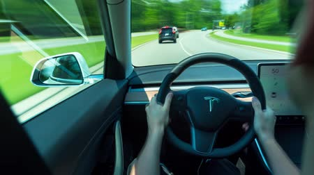 RALEIGH, NC USA, JUNE 22, 2018: Person driving a new Tesla Model 3 in autopilot. The model 3 is set to be the Teslas first mass market electric vehicle