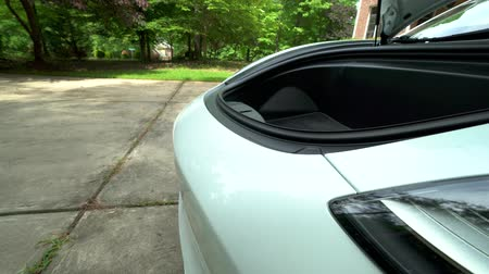battery vehicle : RALEIGH, USA, JULY 03, 2018: View of the front trunk in a new white Tesla Model 3. The model 3 is set to be the Teslas first mass market electric vehicle.