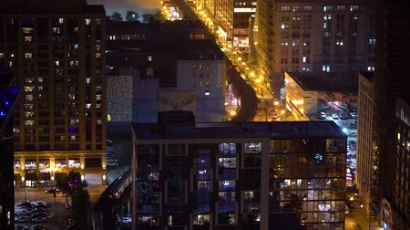 CHICAGO - SEPTEMBER 18th 2018: Trains curve through Downtown Chicago at night via the L CTA system
