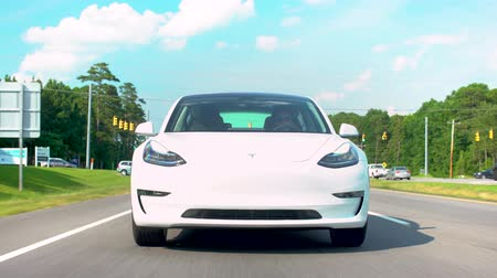 RALEIGH - JUNE 26, 2018: New all electric Tesla Model 3 driving down the road.