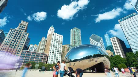 CHICAGO - SEPT. 18th 2018: Tourists visit the Cloud Gate, a public sculpture in Millennium Park in time-lapse