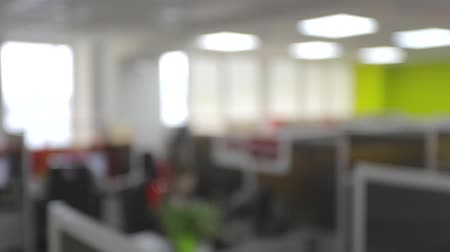 iş istasyonu : Blurred partitions in the office, open space call cener Stok Video
