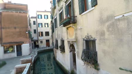 Narrow canal view in Venice, Italy
