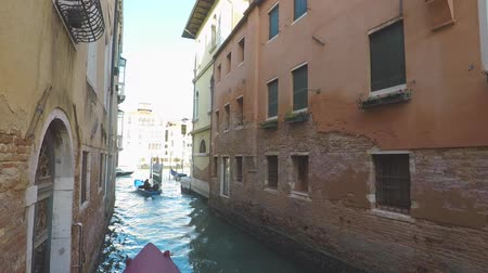 View at canal in Venice, boats around