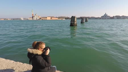 alkony : Girl is taking pictures of the sea in Venice, Italy Stock mozgókép