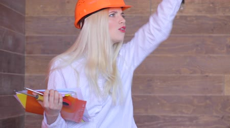 bricks : Angry manager, young woman architect inspects the construction or production Stock Footage