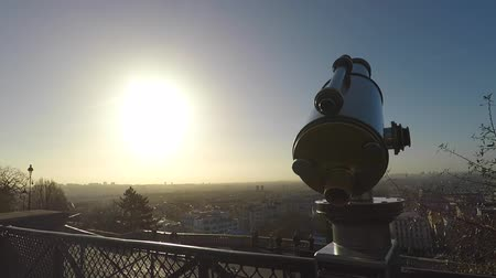 Panoramic view over Paris with binoculars