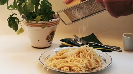 ralado : Spaghetti - freshly cooked and delicious, on the pasta is sprinkled with a rubbed grated hard cheese.