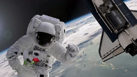 astronauta : Congratulations from space. Astronaut with red rose and shuttle with a heart on it.