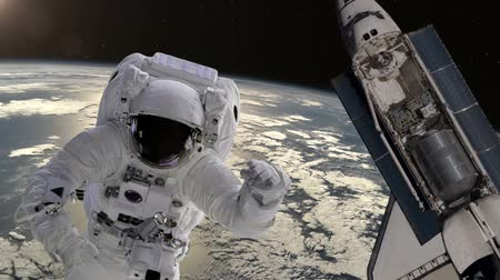 astronauta : Astronaut and shuttle above the Earth. Elements of this video furnished by NASA. Vídeos