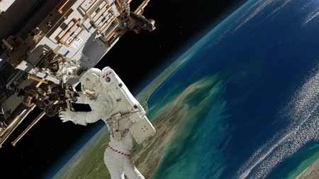 gravidade : Astronaut Working On International Space Station.