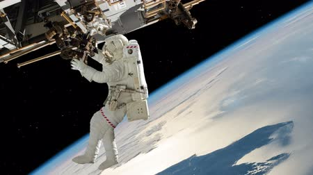 astronauta : Astronaut Working On International Space Station. Elements of this image furnished by NASA