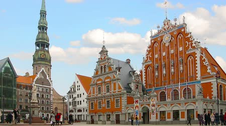riga : House of the Blackheads and the St. Peters Church in Riga Latvia. Timelapse. Stock Footage
