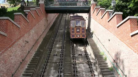 traverse : Budapest, Hungary - CIRCA May, 2016: Funicular full of people traverse a hill.