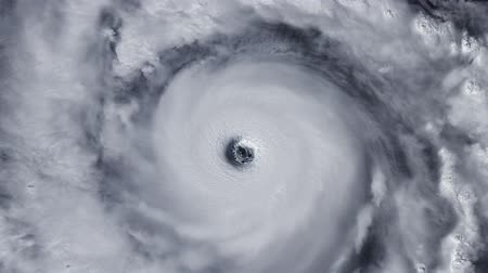 doomsday : Hurricane storm tornado over the Earth from space, satellite view. Zoom Stock Footage