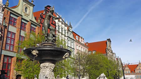europe population : GDANSK, POLAND - May 07 2017: Neptune statue and fountain in the old town of Gdansk