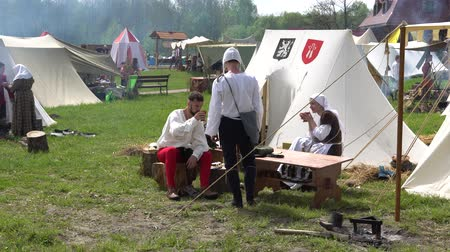 knightly : Minsk, Belarus - May 13, 2017: Festival of military historical reconstruction. KKnights getting ready for battle