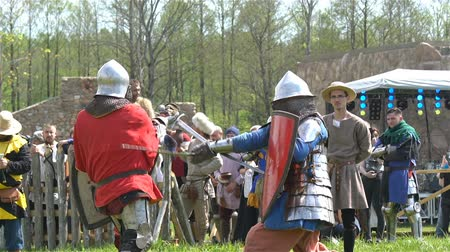 knightly : Minsk, Belarus - May 20 2017: Battle of medieval knights. Duel.