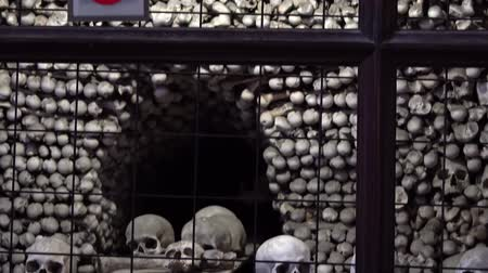 crypt : KUTNA HORA, CZECH REPUBLIC - OCTOBER, 2017: Interior of Ossuary, Kostnice, Czech Republic, Kutna Hora. Human skeletons, skulls and bones.
