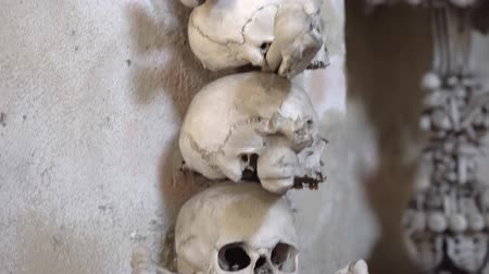 sarcophagus : KUTNA HORA, CZECH REPUBLIC - OCTOBER, 2017: Interior of Ossuary, Kostnice, Czech Republic, Kutna Hora. Human skeletons, skulls and bones.