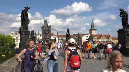 terrakotta : Prague, Czech Republic - JULY 2017: Architecture and traffic in Prague , Czech Republic. Tourists walking along the Charles Bridge in Prague.