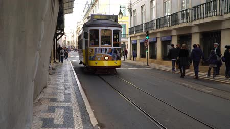 lizbona : LISBON, circa 2017: Old tram passing by in the old town of Lisbon Portugal. Lisbon is the capital of Portugal. Lisbon is continental Europes capital city and the only one along the Atlantic coast.