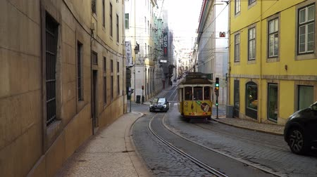 tramwaj : LISBON, circa 2017: Old tram passing by in the old town of Lisbon Portugal. Lisbon is the capital of Portugal. Lisbon is continental Europes capital city and the only one along the Atlantic coast.