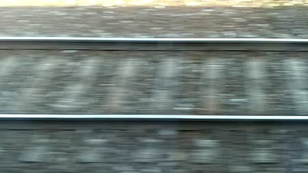 dojíždění : Train passing by. Fast Moving railroad tracks. Rails and sleepers quickly passing.