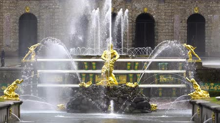 history : St. Petersburg, Peterhof, Russia, June 2018: Grand cascade, famous Petergof fountains In St. Petersburg, Russia. Golden Samson statue fountain in Peterhof park.