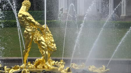 art : St. Petersburg, Peterhof, Russia, June 2018: Grand cascade, famous Petergof fountains In St. Petersburg, Russia. Golden Samson statue fountain in Peterhof park.