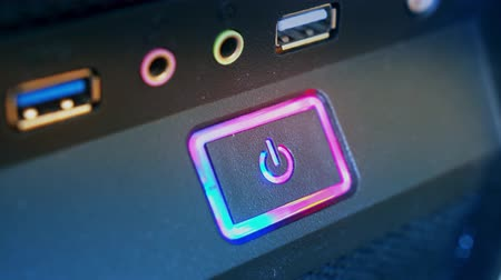 turning off : Pressing button POWER. Male finger presses computer power button. Closeup. Stock Footage
