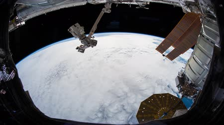 quest : Earth as seen through window of International Space Station ISS . Elements of this image furnished by NASA.