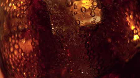 selektif : Cola pouring into the glass with Ice cubes and bubbles. Food background. Soda Close-up. Stok Video
