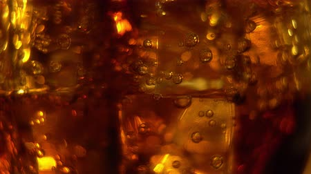 kola : Cola in the glass with Ice cubes and bubbles rotating. Food background. Soda Close-up.