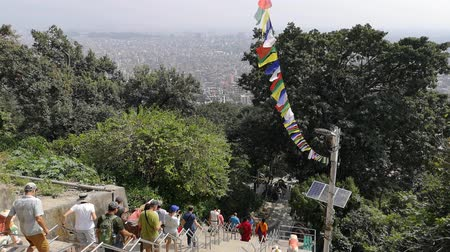 prayer flag : Kathmandu , Nepal - October 2018: Swayambhunath or monkey temle. Kathmandu, Nepal. Swayambhunath, or Swayambu or Swoyambhu, is an ancient religious architecture atop a hill in the Kathmandu Valley.