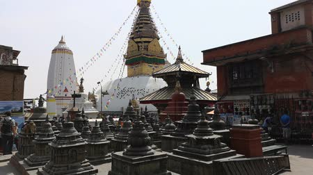sacred site : Kathmandu , Nepal - October 2018: Swayambhunath or monkey temle. Kathmandu, Nepal. Swayambhunath, or Swayambu or Swoyambhu, is an ancient religious architecture atop a hill in the Kathmandu Valley.