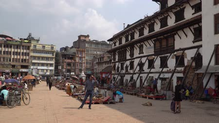 dünya mirası : Kathmandu , Nepal - October 2018: Durbar Square in Kathmandu, Nepal. Kathmandu Durbar Square is one of three Durbar Squares in the Kathmandu in Nepal, all of which are UNESCO World Heritage Sites. Stok Video