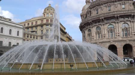bairro : Genoa, Liguria, Italy - CIRCA 2019: Genova fountain Piazza de Ferrari. The famous fountain and the surrounding buildings at Piazza De Ferrari in Genoa In the background the Ducal Palace.