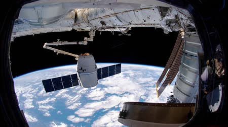 sztratoszféra : International Space Station - Circa May 2019: SpaceX Dragon spacecraft is approaching to the International Space Station. Elements of this video furnished by NASA. ISS 059