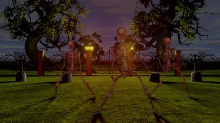 lidércnyomás : Dancing skeletons in the cemetery at night. Halloween concept.