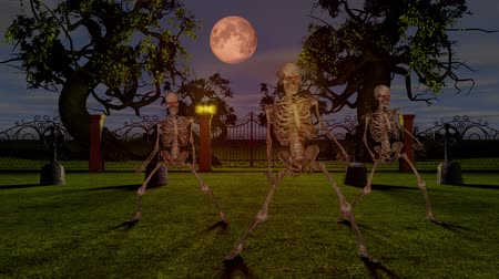 ゴシック : Dancing skeletons in the cemetery at night. Halloween concept.