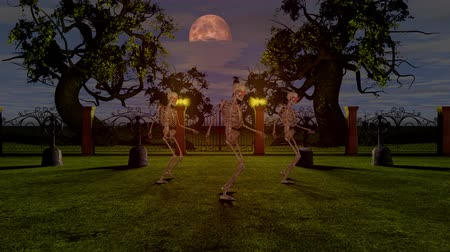 Dancing skeletons in the cemetery at night. Halloween concept.