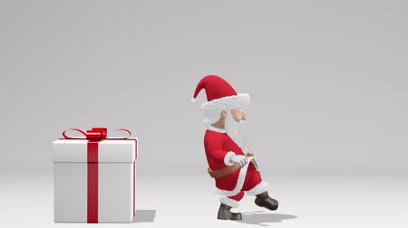 Santa Claus Pushing Gift. Merry Christmas and Happy New Year 2020 animation. Santa Claus with a Christmas gift near the Christmas tree. With alpha channel.