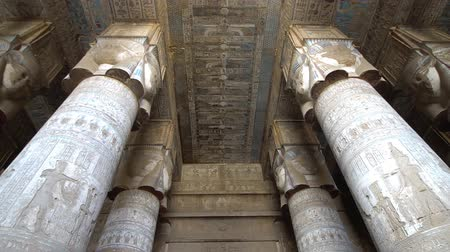 worship : Interior of Dendera temple or Temple of Hathor. Egypt. Dendera, Denderah, is a small town in Egypt. Dendera Temple complex, one of the best-preserved temple sites from ancient Upper Egypt. Stock Footage