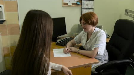 complaints : The girl on reception at the doctor. Stock Footage