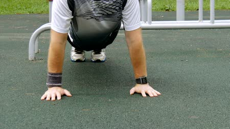 lift ups : A man is exercising at an open pitch