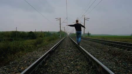 hobo : Man walking on the railroad Stock Footage