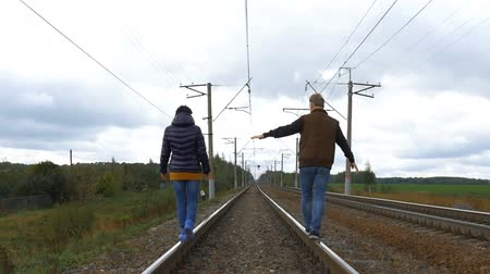 bengala : Couple walking on railroad tracks Stock Footage